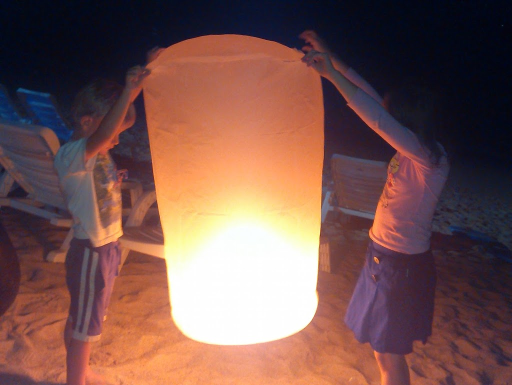 Sailing cruises highlights: The kids getting ready to launch a lantern on new years eve